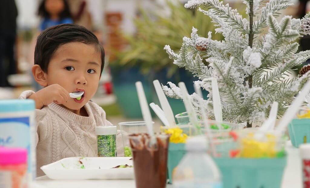 boy-holiday-sweater-eating-1024x620
