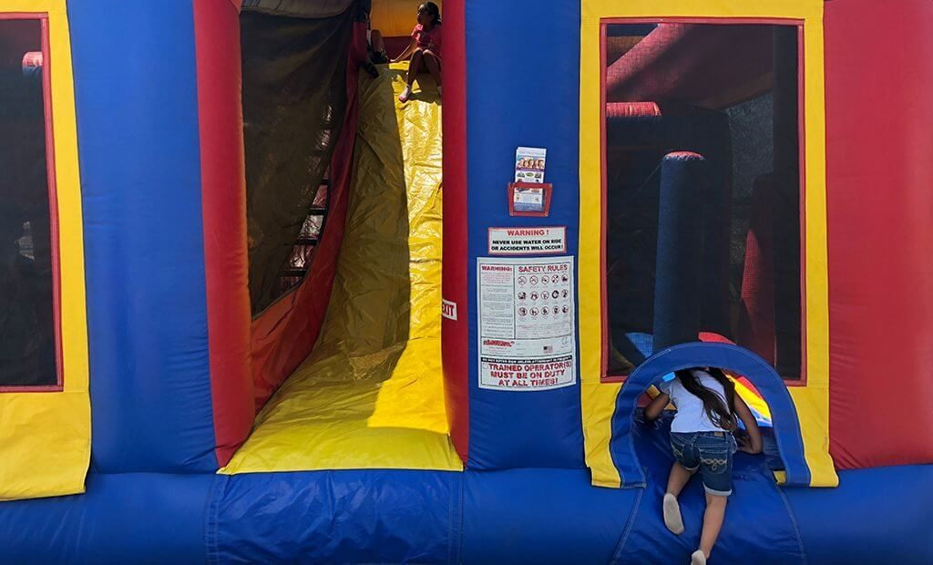 crawling-into-bouncy-castle-1024x620
